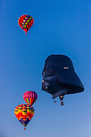 "Aerial view, hot air balloons (including ""Darth Vader"" from Belgium)  flying during the Albuquerque International Balloon Fiesta, Albuquerque, New Mexico USA."