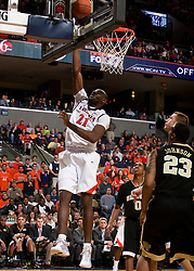 Virginia center Tunji Soroye (21) finishes a layup against Wake.  The Virginia Cavaliers fell to the #13 ranked Wake Forest Demon Deacons 70-60 at the John Paul Jones Arena on the Grounds of the University of Virginia in Charlottesville, VA on February 28, 2009.
