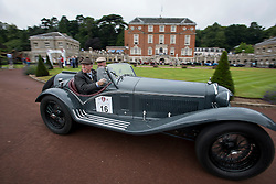 © Licensed to London News Pictures. 13/07/2015. Epsom, UK. PAUL GREGORY and NICK SAVAGE set off from Woodcote Park in their 1933 Alfa Romeo Touring Spider. The start of The Royal Automobile Club 1000 Mile Trial 2015 at Woodcote Park in Epsom, Surrey. The event, which starts and finishes at Woodcote Park, takes a fleet of over 40 classic cars from around the world, through a 1000 mile trial around the UK.  Photo credit: Ben Cawthra/LNP
