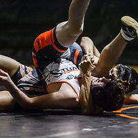 Grants Pirate Johnathan Neaf and Gallup Bengal Isaiah Scott grapple on the mat at Gallup High School Wednesday.