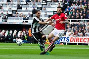 Barnsley defender Adam Jackson (#18) stabs the ball away from Newcastle United forward Ayoze Perez (#17) during the EFL Sky Bet Championship match between Newcastle United and Barnsley at St. James's Park, Newcastle, England on 7 May 2017. Photo by Craig Doyle.