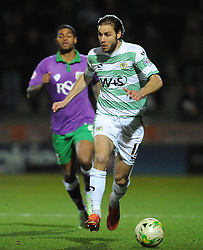 Yeovil Town's Sam Foley is tackled by Bristol City's Mark Little  - Photo mandatory by-line: Harry Trump/JMP - Mobile: 07966 386802 - 10/03/15 - SPORT - Football - Sky Bet League One - Yeovil Town v Bristol City - Huish Park, Yeovil, England.