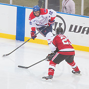 Josh Holmstrom #12 of the UMass Lowell Riverhawks in action during the Frozen Fenway game between The Northeastern Huskies and The UMass Lowell Riverhawks at Fenway Park on January 11, 2014 in Boston, Massachusetts.