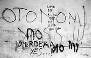 Anti-independence and pro-independence graffiti Dili East Timor September 1999<br /> &copy;David Dare Parker/AsiaWorks Photography