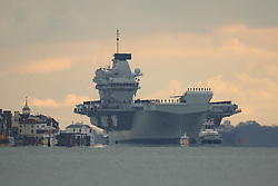 © Licensed to London News Pictures. 16/11/2019. Portsmouth, UK. HMS Prince of Wales, sister aircraft carrier of HMS Queen Elizabeth, sails into it's home port of Portsmouth for the first time. The Royal Navy's latest aircraft carrier sailed from Rosyth dockyard to begin sea trials in September. The ship, which is 280 metres long and weighs 65,000 tonnes, is expected to be commissioned into the Royal Navy in 2020. Photo credit: Peter Macdiarmid/LNP