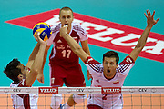 (L) Lukasz Zygadlo from Poland in action during the 2013 CEV VELUX Volleyball European Championship match between Poland v Slovakia at Ergo Arena in Gdansk on September 22, 2013.<br /> <br /> Poland, Gdansk, September 22, 2013<br /> <br /> Picture also available in RAW (NEF) or TIFF format on special request.<br /> <br /> For editorial use only. Any commercial or promotional use requires permission.<br /> <br /> Mandatory credit:<br /> Photo by &copy; Adam Nurkiewicz / Mediasport