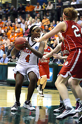 20 March 2010: Philana Greene charges the lane but is confronted by Alex Hoover. The Flying Dutch of Hope College fall to the Bears of Washington University 65-59 in the Championship Game of the Division 3 Women's NCAA Basketball Championship the at the Shirk Center at Illinois Wesleyan in Bloomington Illinois.