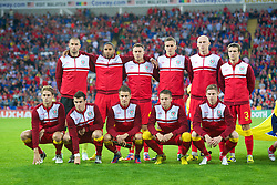 CARDIFF, WALES - Friday, September 7, 2012: Wales' players line up for a team group photograph before the 2014 FIFA World Cup Brazil Qualifying Group A match against Belgium at the Cardiff City Stadium. Back row L-R: goalkeeper Boaz Myhill, Ashley Williams, Darcy Blake, Steve Morison, James Collins, Adam Matthews. Front row L-R: David Edwards, Gareth Bale, captain Aaron Ramsey, Chris Gunter, Simon Church. (Pic by David Rawcliffe/Propaganda)