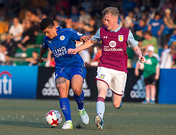 May 28, 2017 - Hong Kong, Hong Kong SAR, China - Leicester City player Joshua Gordon (L) keeps the ball free of Aston Villa's Jake Doyle-Hayes (R).Leicester City win their second HKFC Citi Soccer Sevens title following a 3-0 victory over defending champions Aston Villa in the final.2017 Hong Kong Soccer Sevens at the Hong Kong Football Club Causeway Bay. (Credit Image: © Jayne Russell via ZUMA Wire)