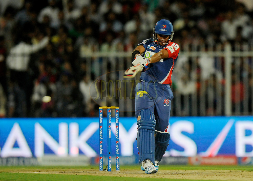 Jean-Paul Duminy of the Delhi Daredevils bats during match 2 of the Pepsi Indian Premier League Season 7 between the Delhi Daredevils and The Royal Challengers Bangalore held at the Sharjah Cricket Stadium, Sharjah, United Arab Emirates on the 17th April 2014<br /> <br /> Photo by Pal Pillai / IPL / SPORTZPICS
