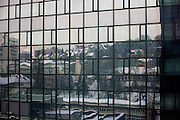Reflection of the Sarajevo cityscape in a skyscraper in the center of the Bosnian capital.