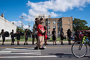 Members of the Kenwood Academy Marching Band await their entrance to the Bud Billiken Parade on Pershing Road on August 12, 2017.