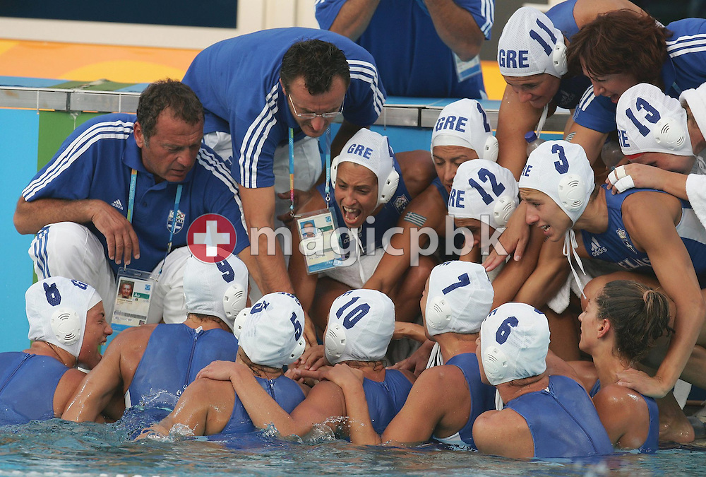 Greek players take a time-out during the women's Water Polo gold medal match Greece vs Italy of the Athens 2004 Olympic Games at the Olympic Aquatic Centre in Athens Thursday 26 August 2004. Italy won 10-9.  (Photo by Patrick B. Kraemer / MAGICPBK)