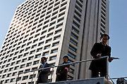 "Social welfare activists atop a van prepare to speak at the start of the rally following the Anti poverty Protest ""Tent Village"" in Hibiya Park, Tokyo, Japan. Monday, January 5th 2009.Organised by the Moyai Foundation, headed by Makoto Yuasa, for the six days the event lasted over the New Year`s holiday in 2009 about 1,600 volunteers helped over 500 of Japan`s homeless and unemployed with food, shelter and advice."