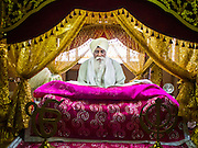 "08 FEBRUARY 2015  BANGKOK, THAILAND:  A man studies Sikh texts in a Guru Granth Sahib at the Sikh temple in Bangkok. Thailand has a small but influential Sikh community. Sikhs started coming to Thailand, then Siam, in the 1890s. There are now several thousand Thai-Indian Sikh families. Gurdwara Siri Guru Singh Sabha was established in 1913. Construction of the current building, adjacent to the original Gurdwara (""Gateway to the Guru""), started in 1979 and was finished in 1981. The Sikh community serves a daily free vegetarian meal at the Gurdwara that is available to people of any faith and background.   PHOTO BY JACK KURTZ"