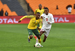 South Africa: Johannesburg: Bafana Bafana player Lebohang Maboe battle for the ball with Seychelles player Colin Esther during the Africa Cup Of Nations qualifiers at FNB stadium, Gauteng.<br />