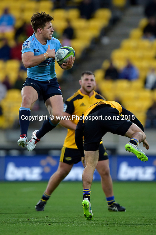 Waratahs' Bernard Foley (L) jumps for the ball with Hurricanes' fullback Nehe Milner-Skudder during the Super Rugby - Hurricanes v Waratahs rugby union match at the Westpac Stadium in Wellington on Saturday the 18th of April 2015. Photo by Marty Melville / www.Photosport.co.nz