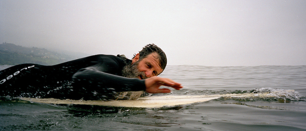 Rabbi Nachum Shifren, 54, catches waves at Venice Beach, CA., on Sunday, April 30, 2006. Born in to a Jewish Family in Los Angeles, CA., Shifren was not a religious person when he began surfing at the age of 12. At the age of 33, Shifren began to follow the Jewish tradition and practice Kabala, and since then has been know as ?The Surfing Rabbi.? Today, Shifren lives in Venice Beach, CA., and teaches surfing and kabala to students around the world.