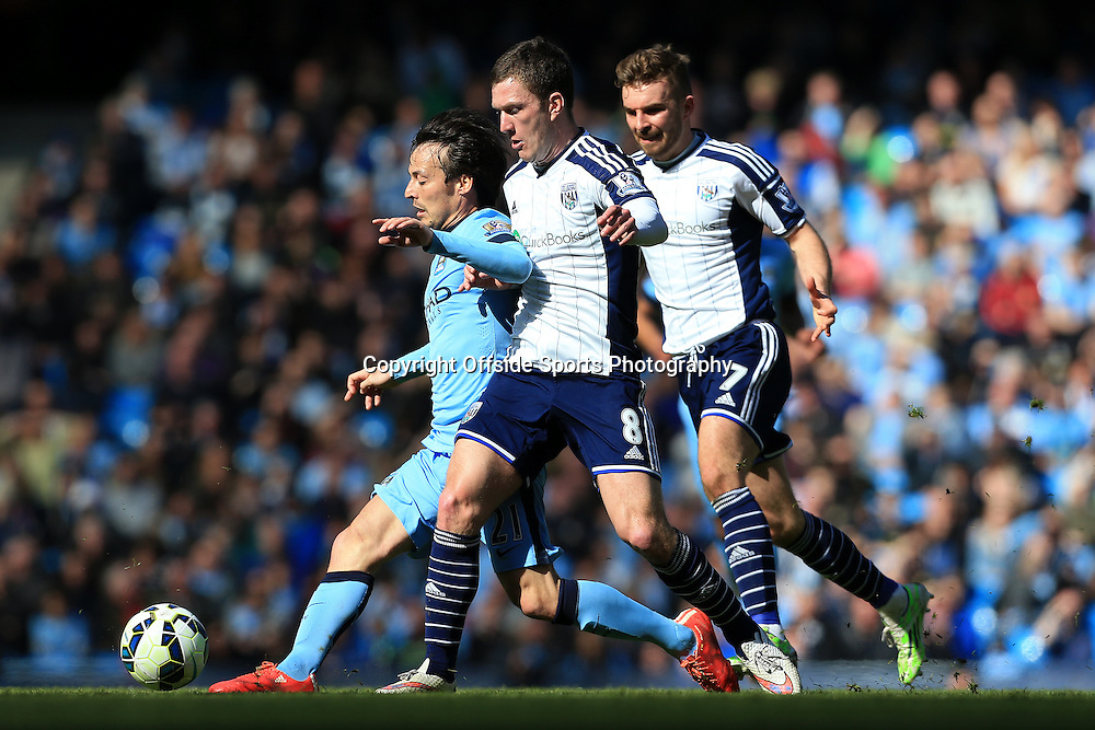 21st March 2015 - Barclays Premier League - Manchester City v West Bromwich Albion - David Silva of Man City battles with Craig Gardner of West Brom (C) and James Morrison of West Brom (R) - Photo: Simon Stacpoole / Offside.