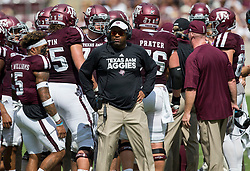 Texas A&M head coach Kevin Sumlin waits with his team during a timeout against Louisiana-Lafayette of an NCAA college football game Saturday, Sept. 16, 2017, in College Station, Texas. (AP Photo/Sam Craft)