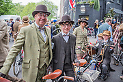 "A family dressed in home made suits (made by their father who is not a tailor) - The Tweed Run - a group bicycle ride through the centre of London, in which the cyclists are expected to dress in traditional British cycling attire, particularly tweed plus four suits. Any bicycle is acceptable on the Tweed Run, but classic vintage bicycles are encouraged in an effort to recreate the spirit of a bygone era. The ride dubs itself ""A Metropolitan Cycle Ride With a Bit of Style."" London 06 May 2017"