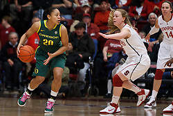 February 26, 2011; Stanford, CA, USA;  Oregon Ducks guard Ariel Thomas (20) is defended by Stanford Cardinal guard Lindy La Rocque (right) during the first half at Maples Pavilion.  Stanford defeated Oregon 99-60.