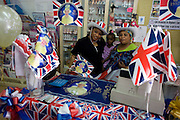 Party shop owners with patriotic bunting, flags and royal memorabilia on display before the Queen's diamond Jubilee in a south London business.
