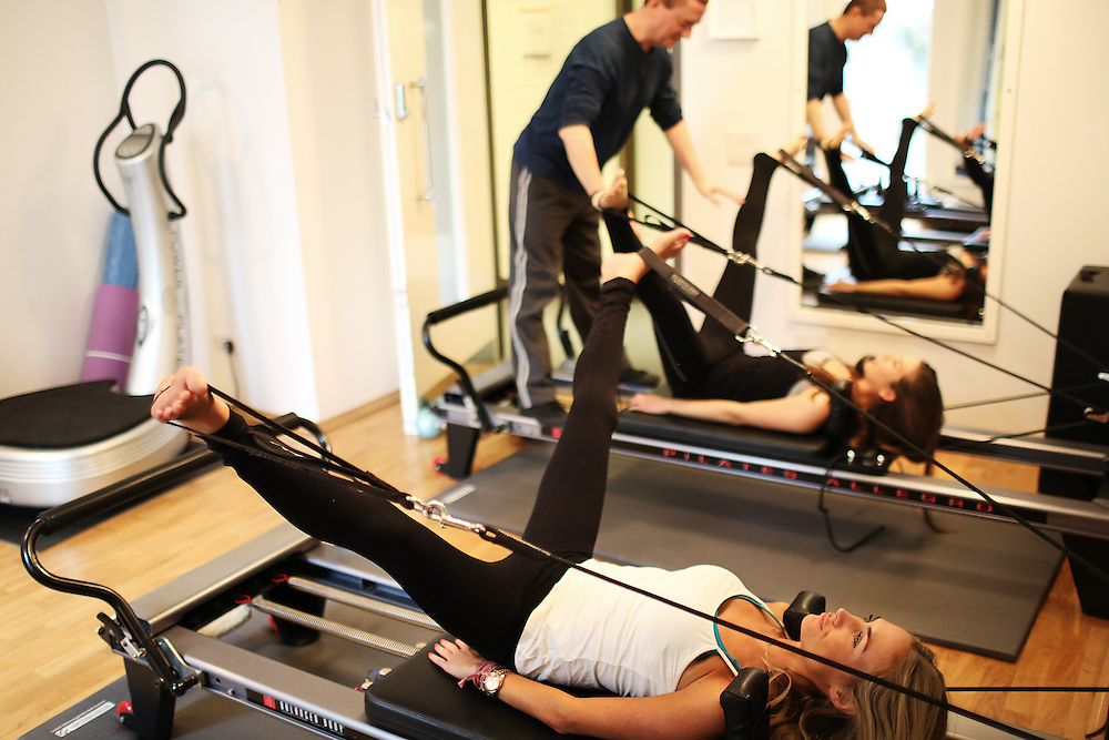 Daniele Boido shows from front  to back Ashley Warwa, Lara Somogyi at  (body Works West) a pilates workout Saturday, 23, February 2013....Photo By Ki Price for The Times