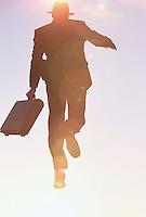 Businessman Jumping in the Air --- Image by © Jim Cummins/CORBIS