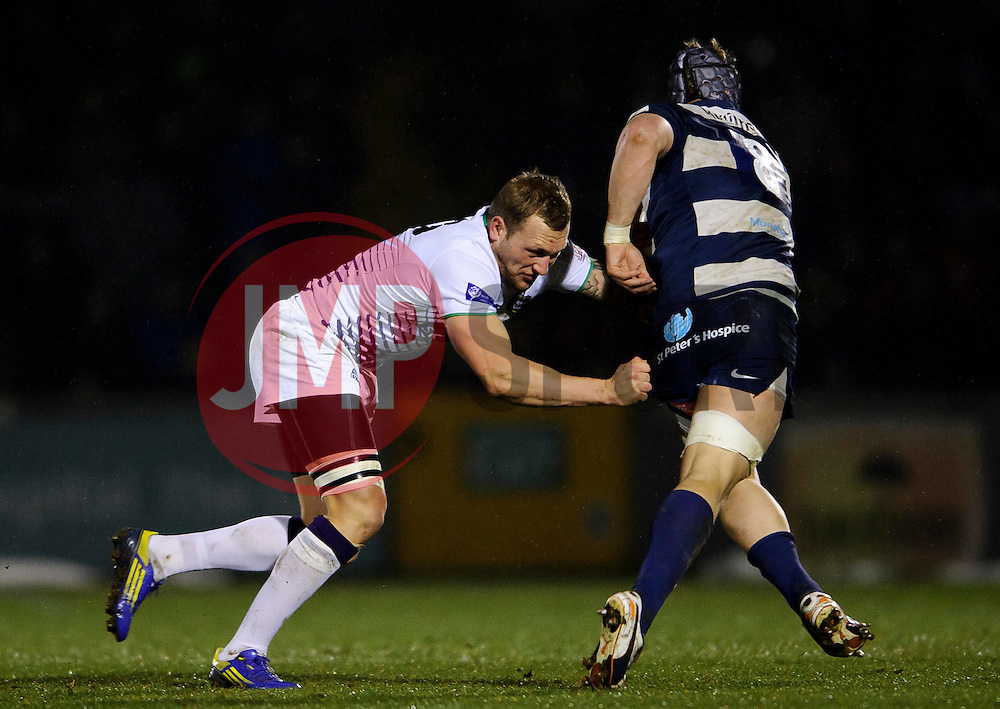 Bristol Number 8 (#8) Mitch Eadie is tackled by Leeds Carnegie Outside Centre (#13) Josh Griffin during the first half of the match - Photo mandatory by-line: Rogan Thomson/JMP - Tel: Mobile: 07966 386802 25/01/2013 - SPORT - RUGBY - Memorial Stadium - Bristol. Bristol v Leeds Carnegie - RFU Championship.