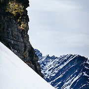 Griffin Post skiing a ridgeline in Glacier National Park.