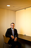Corporate portrait of David Brooks in a meeting room