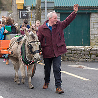 Local man Anthony Carrig leads the way with his donkey Jennie carrying the time capsule to the cathedral