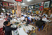Souvenir factory and shop for tourists along the road from Hanoi to Halong Bay.