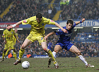 Photo: Lee Earle.<br /> Chelsea v Colchester United. The FA Cup. 19/02/2006. Colchester's Greg Halford (L) battles with Joe Cole.