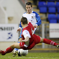 St Johnstone v Stirling....26.01.08 <br /> Kevin Moon avoids a lunge by Brian Allison before firing home saints second goal<br /> Picture by Graeme Hart.<br /> Copyright Perthshire Picture Agency<br /> Tel: 01738 623350  Mobile: 07990 594431