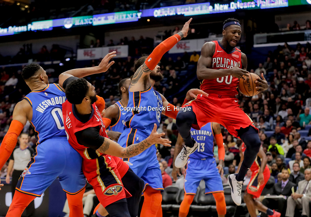 Dec 12, 2018; New Orleans, LA, USA; New Orleans Pelicans forward Julius Randle (30) rebounds over Oklahoma City Thunder center Steven Adams (12) during the second half at the Smoothie King Center. Mandatory Credit: Derick E. Hingle-USA TODAY Sports