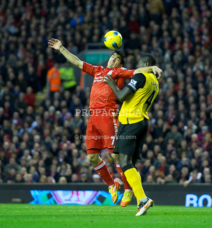 LIVERPOOL, ENGLAND - Boxing Day Monday, December 26, 2011: Liverpool's Luis Alberto Suarez Diaz in action against Blackburn Rovers's Christopher Samba during the Premiership match at Anfield. (Pic by David Rawcliffe/Propaganda)
