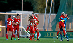 NEWPORT, WALES - Tuesday, June 12, 2018: Wales players celebrate at the final whistle after beating Russia 3-0 during the FIFA Women's World Cup 2019 Qualifying Round Group 1 match between Wales and Russia at Newport Stadium. Rachel Rowe, Hayley Ladd, Jessica Fishlock, Loren Dykes, captain Sophie Ingle, Nadia Lawrence, goalkeeper Laura O'Sullivan. (Pic by David Rawcliffe/Propaganda)
