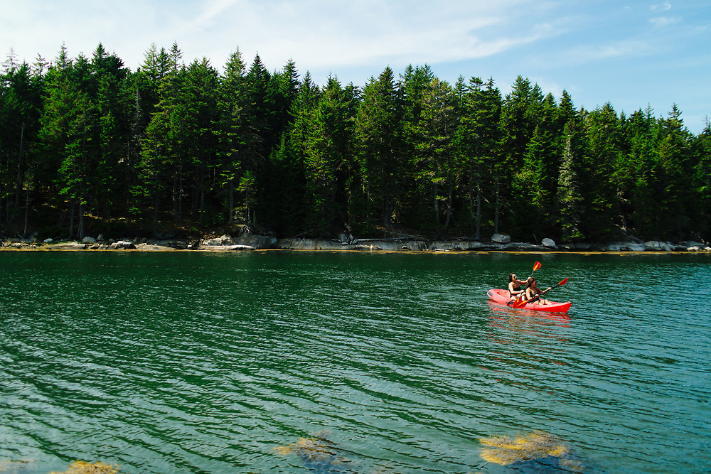 Young Women Kayaking on Ocean, Vinalhaven, Maine.