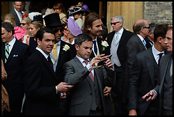 Guest take pictures at the wedding of Poppy Delevingne to James Cook at St.Paul's Church in Knightsbridge, London,  Friday, 16th May 2014. Picture by Andrew Parsons / i-Images