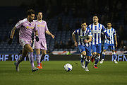 Reading midfielder Daniel Williams (23) is approached by Brighton striker, Sam Baldock (9) during the Sky Bet Championship match between Brighton and Hove Albion and Reading at the American Express Community Stadium, Brighton and Hove, England on 15 March 2016. Photo by Geoff Penn.