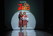 Martine Reardon, of Macy's, and Nancy Brown, at podium, CEO, American Heart Association, speak before the Go Red For Women The Heart Truth Red Dress Collection 2014, made possible by Macy's and SUBWAY Restaurants, Thursday, Feb. 6, 2014, during Fashion Week in New York.  (Photo by Diane Bondareff for Go Red For Women)