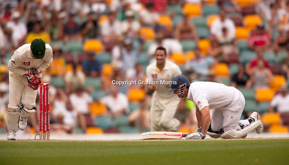 Andrew Strauss is stumped by Brad Haddin off the bowling of Marcus North for 110 during his century in the first Ashes Test Match between Australia and England at the Gabba, Brisbane. Photo: Graham Morris (Tel: +44(0)20 8969 4192 Email: sales@cricketpix.com) 28/11/10