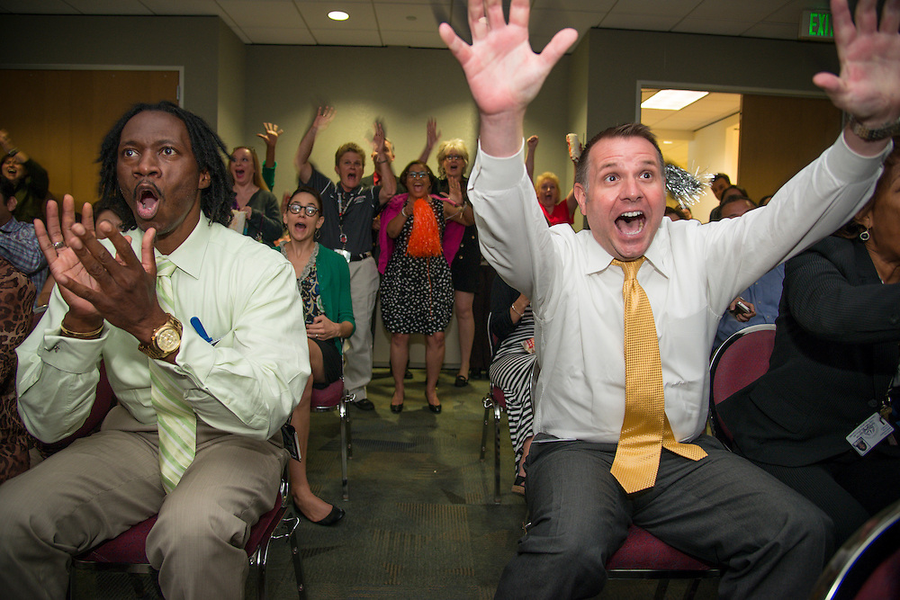 Houston Independent School District Apollo School Support Officer Ken Davis, left, and Assistant Superintendent Lance Menster, right, react during a watch party to the announcement that HISD is the winner of the 2013 Broad Prize for Urban Education, September 25, 2013.