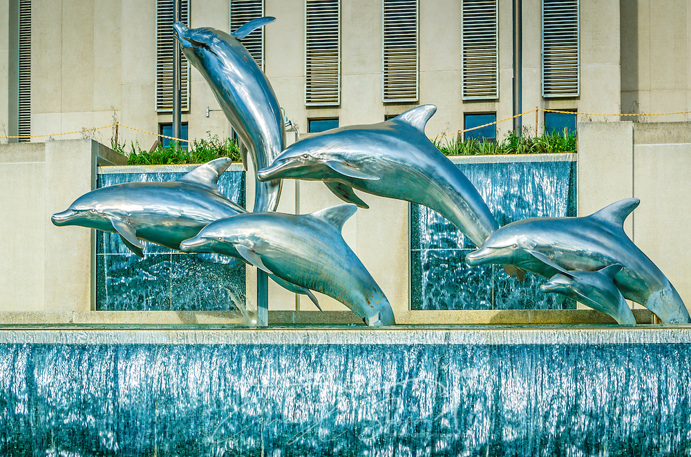 """Dolphins frolic in Waller Park's Florida Heritage Fountain at the Florida State Capitol, July 20, 2013, in Tallahassee, Florida. The five ton aluminum and steel sculpture, """"Stormsong,"""" was created by Tallahassee artist Hugh Branford Nicholson. (Photo by Carmen K. Sisson/Cloudybright)"""