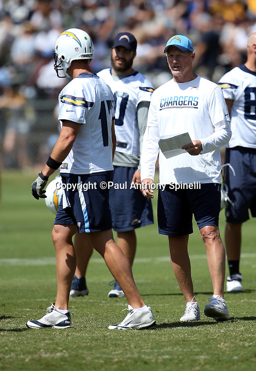 San Diego Chargers offensive coordinator Kenn Whisenhunt talks to San Diego Chargers quarterback Philip Rivers (17) during a break in the action during the Chargers 2016 NFL minicamp football practice held on Tuesday, June 15, 2016 in San Diego. (©Paul Anthony Spinelli)