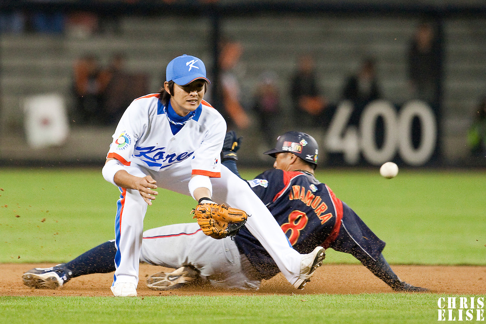 19 March 2009: #8 Akinori Iwamura of Japan slides safely into second base against #8 Keun Woo Jeong of Korea during the 2009 World Baseball Classic Pool 1 game 6 at Petco Park in San Diego, California, USA. Japan wins 6-2 over Korea.