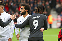 Football - 2019 / 2020 Premier League - AFC Bournemouth vs. Liverpool<br /> <br /> The Bournemouth players shake hands with the Liverpool players before kick off with tops on with Benik Afobe's No9 on in respect of the death of Afobe's daughter at the Vitality Stadium (Dean Court) Bournemouth <br /> <br /> COLORSPORT/SHAUN BOGGUST