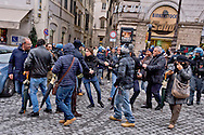 Rome, Italy. 5th January 2016<br /> Plain clothed policemen, arrest a demonstrator during a protest against evictions in Rome's Piazza Santi Apostoli in front of the Prefecture in Rome. The police arrested 18 protesters.